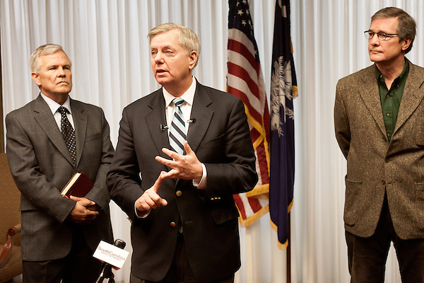 March 26, 2013. Columbia, South Carolina. Sen. Lindsey Graham addresses members of the press on the issue of immigration reform. He was joined by Dr. Jim Goodroe, a state evangelical leader (left), and Hal Stevenson, the owner of Grace Outdoor (right).. Sen. Lindsey Graham, R- South Carolina, is up for reelection in 2014. He spent some time talking to his base back home about issues such as immigration reform as he readies himself for his campaign run..