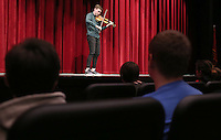 NWA Democrat-Gazette/DAVID GOTTSCHALK  Violinist Alexi Kenney performs Thursday, March 2, 2017, for a group of fine arts students at the new Farmington High School Performing Arts Center. Kenney's engagement is part of the Symphony of Northwest Arkansas's education outreach commitment. Kenney is performing with SONA as part of their Masterworks concerts series this weekend.