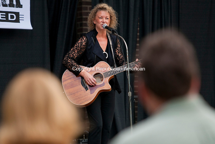 TORRINGTON, CT 20 SEPTEMBER 2014-092014JS02--Musician Lisa Martin of Ludlow, Mass. performs during Coe Park Unplugged concert Saturday at Coe Park in Torrington. The event, hosted by the city's Arts &amp; Culture and Parks &amp; Recreation commissions, featured six musical performances throughout the day. <br /> Jim Shannon Republican-American