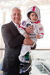 Garden City, New York, USA. June 21, 2018. Space Shuttle Astronaut MIKE MASSIMINO is holding GIOVANNI, 3 1/2 years old, from Manhasset, after the museum's Members Meet & Greet before Massimino give free lecture in JetBlue Sky Theater Planetarium at the Cradle of Aviation's Museum's Evening with Mike Massimino Lecture, part of the museum's Countdown to Apollo at 50, celebrating 50th anniversary of Apollo 11 moon landing on July 20, 1969.