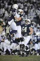 22 November 2008:  Penn State QB Daryll Clark (17) jumps and chest bumps / celebrates with TE Mickey Shuler (82) after he threw a 70 yard TD pass during the 3rd quarter.  The Penn State Nittany Lions defeated the Michigan State Spartans 49-18 to win the Land Grant Trophy and 2008 Big Ten Conference Championship at Beaver Stadium in State College, PA..