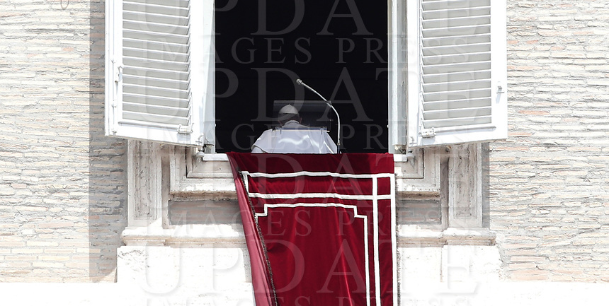 Papa Francesco si allontana dalla finestra del suo studio, affacciato su piazza San Pietro, dopo l'Angelus domenicale, Citta' del Vaticano, luglio 7, 2019.<br /> Pope Francis leaves at the end of the Sunday Angelus noon prayer from the window of his studio overlooking St. Peter's Square, at the Vatican, on July 7, 2019.<br /> UPDATE IMAGES PRESS/Isabella Bonotto<br /> <br /> STRICTLY ONLY FOR EDITORIAL USE