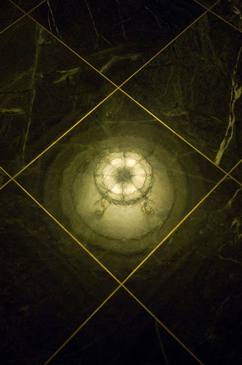 WASHINGTON, DC - Sept. 06: Reflection on the floor of a light fixture in the Longworth House Office building near the House Ways and Means Committee meeting room. (Photo by Scott J. Ferrell/Congressional Quarterly).