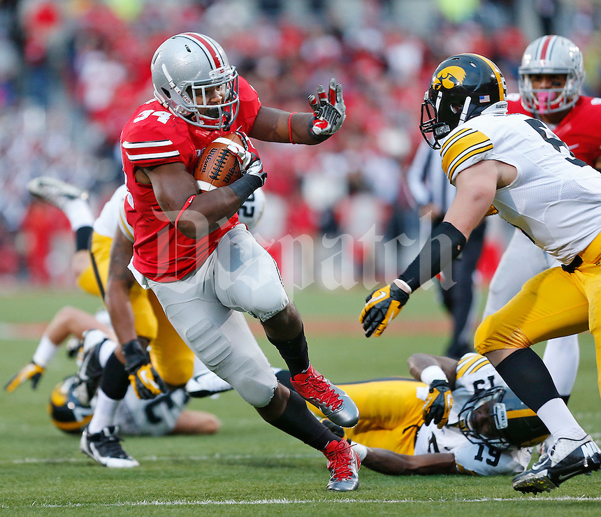 Ohio State Buckeyes running back Carlos Hyde (34 fends off Iowa Hawkeyes defensive back Tanner Miller (5) on his way to a diving TD in the fourth quarter at Ohio Stadium on October 19, 2013.  (Chris Russell/Dispatch Photo)
