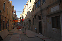Repairs to narrow street in Venice, Italy