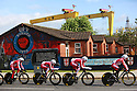 Team Katusha (Russian) cycle past pro-British Loyalist murals of east Belfast during practice session before the 2014 Giro d'Italia cycling race in Belfast, Northern Ireland, 09 May 2014. Belfast is hosting the Giro d'Italia Big Start (Grande Partenza) with three days of cycling action from 9 to 11 May 2014.