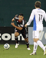 J.P. Rodrigues #31 of D.C. United moves towards Bobby Convey #11 of the San Jose Earthquakes during an MLS match at RFK Stadium in Washington D.C. on October 9 2010. San Jose won 2-0.