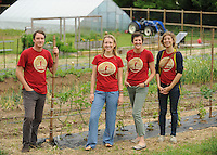 NWA Democrat-Gazette/ANDY SHUPE<br /> Cale Nicholson (from left), teaching farm manager for Apple Seeds, Inc.; Brett Williams, farm program coordinator; Kyra Ramsey, co-executive director; and Kassia Rudd, school garden program coordinator; pose for a photograph Thursday, May 28, 2015, at the farm in Fayetteville. Apple Seeds is a nonprofit farm that provides nutrition and urban farming instruction in Fayetteville.