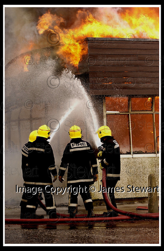 28/1/2002                 Copyright Pic : James Stewart                     .File Name : stewart-deanburn fire 05.FIREMEN BATTLE AGAINST THE HIGH WINDS TO BRING THE FIRE AT DEANBURN PRIMARY SCHOOL. BO'NESS, UNDER CONTROL.....(see copy from Jim Davis).....James Stewart Photo Agency, Stewart House, Stewart Road, Falkirk. FK2 7AS      Vat Reg No. 607 6932 25.Office : +44 (0)1324 630007     .Mobile : + 44 (0)7721 416997.Fax     :  +44 (0)1324 630007.E-mail : jim@jspa.co.uk.If you require further information then contact Jim Stewart on any of the numbers above.........