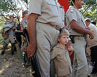 Children and members of the Afrikaner Resistance Movement) (AWB), a South African far right secessionist political organization and former paramilitary. The AWB is committed to the creation of an independent Boer-Afrikaner republic in part of South Africa. In its heyday in the 1980s and 90s, the organization received much publicity both in South Africa and internationally as a white supremacist and neo-fascist group.