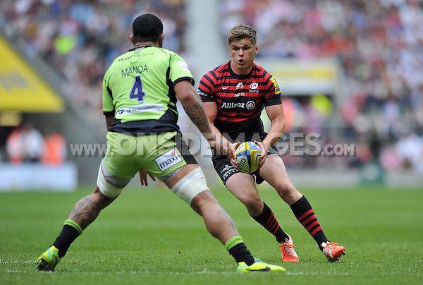 Owen Farrell in possession. Aviva Premiership Final, between Saracens and Northampton Saints on May 31, 2014 at Twickenham Stadium in London, England. Photo by: Patrick Khachfe / JMP