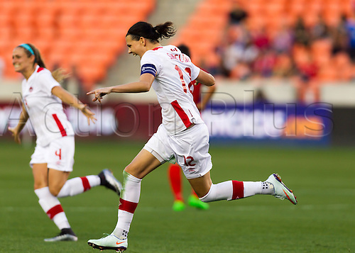 19.02.2016. Houston, TX, USA.  Canada Forward Christine Sinclair (12)  celebrates her second goal in the second half during the Women's Olympic semi-final qualifying game between Canada and Costa Rica at BBVA Compass Stadium in Houston, Texas.