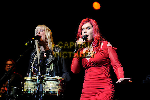 Cindy Wilson and Katie Pierson<br /> The B 52's performing in concert, Indigo2, Greenwich, London, England. 16th August 2013<br /> on stage in concert live gig performance performing music half length black leather jacket drums red dress singing <br /> CAP/MAR<br /> &copy; Martin Harris/Capital Pictures