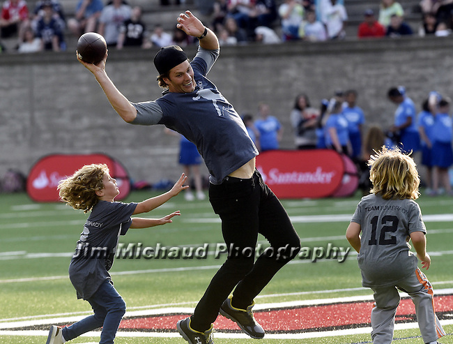 (Boston, Ma 06/03/16)  Tom  Brady is chased down by two pint sized defenders, Joey Shiver, 6, left, son of Anthony Shiver and family friend Lucas Bacardi Shriftman, during Best Buddies, Friday, June 3, 2016, at Harvard Stadium. Herald Photo by Jim Michaud
