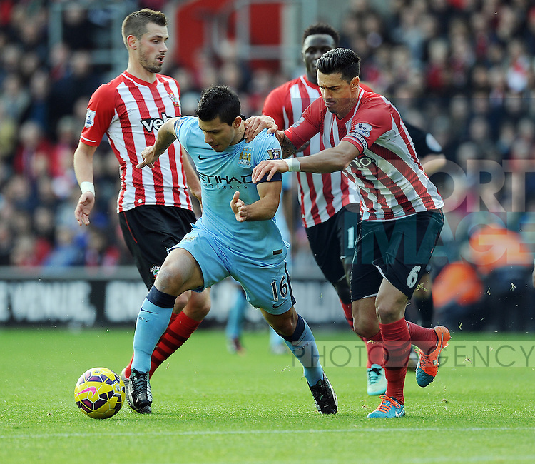 Sergio Aguero of Manchester City is challenged by Jose Fonte of Southampton<br /> - Barclays Premier League - Southampton vs Manchester City - St Mary's Stadium - Southampton - England - 30th November 2014 - Pic Robin Parker/Sportimage