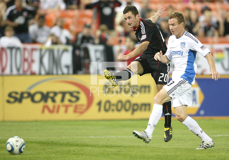 Stephen King #20 of D.C. United blasts a shot past Chris Leitch #3 of the San Jose Earthquakes during an MLS match at RFK Stadium in Washington D.C. on October 9 2010. San Jose won 2-0.