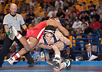 March 21 2009        Jordan Burroughs (red) of Nebraska battled against Michael Poeta (blue) of Illinois in the 157 pound weight class in the championship round of the NCAA Division I  Wrestling Championships which were held March 19 through March 21, 2009 at the Scottrade Center in downtown St. Louis, Missouri.  Burroughs won...         *******EDITORIAL USE ONLY*******