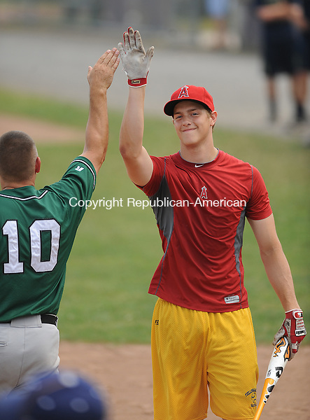TORRINGTON, CT-04 JULY 2012--070412JS01-Justin Morhardt get a high five from Ed Gadomski after winning the Public Home Run Derby Wednesday prior to the Torrington Titans game against with the Tri-State Baseball League All-Stars at Fuessenich Park in Torrington. .Jim Shannon Republican-American