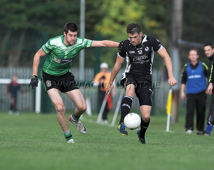 5th October 2013; Steward Lowndes, St Peregrines, in action against Marc O'Tuama, Lucan Sarsfields. Dublin Senior Football Championship, St Peregrines v Lucan Sarsfields, Blakestown, Dublin. Picture credit: Tommy Grealy / Actionshots.ie