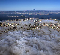 aerial photograph of San Francisco, California toward Mount Diablo with fog covering the western part of the city, 2005