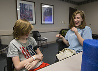 Dylan Rogers, 11, and sister McKenna Rogers, 13, of Rogers practice using a tourniquet Wednesday, Feb. 26, 2020, during a Stop the Bleed class at Northwest Medical Center in Bentonville. The class, free for the public, taught participants how to use stop bleeding and save lives after a traumatic injury. Go to nwaonline.com/photos to see more photos.<br />