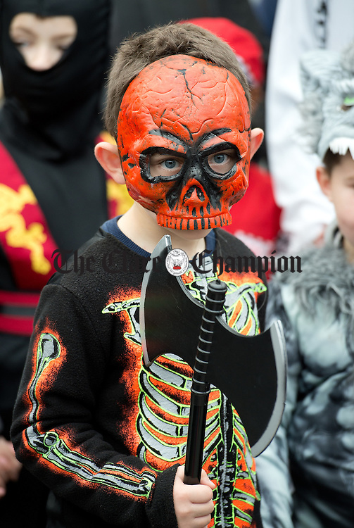 A pupil from Ennis Holy Family school attending a public performance in the Market before the annual  Clare Champion Halloween Party. Photograph by John Kelly.