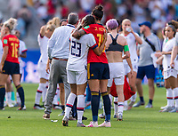 REIMS,  - JUNE 24: Christen Press #23 embraces Jennifer Hermoso #10 during a game between NT v Spain and  at Stade Auguste Delaune on June 24, 2019 in Reims, France.