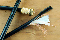 COAXIAL CABLE<br /> Cutaway<br /> Consists of several copper tubes; each tube contains a wire conductor that extends along its center. The entire cable is sheathed in lead and is generally filled with nitrogen under pressure to prevent corrosion.