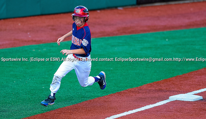 Newtown(CT)'s Connor Barrett rounds third base during the Cal Ripken Babe Ruth World Series in Aberdeen, Maryland on August 12, 2012