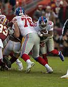 New York Giants running back Wayne Gallman, Jr. (22) runs into offensive tackle Nate Solder (76) as he carries the ball in the fourth quarter against the Washington Redskins at FedEx Field in Landover, Maryland on Sunday, December 9, 2018.  The Giants won the game 40 - 16.<br /> Credit: Ron Sachs / CNP<br /> (RESTRICTION: NO New York or New Jersey Newspapers or newspapers within a 75 mile radius of New York City)