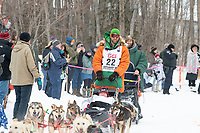 Kelly Maixner and team run past spectators on the bike/ski trail near University Lake with an Iditarider in the basket and a handler during the Anchorage, Alaska ceremonial start on Saturday, March 7 during the 2020 Iditarod race. Photo © 2020 by Ed Bennett/Bennett Images LLC