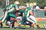 Manhattan Beach, CA 10/27/11 - Jake Shampine-Meistrell (Mira Costa #7) and Triston Martinez (Peninsula #70) in action during the Peninsula vs Mira Costa Junior Varsity football game.