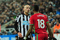 Jonjo Shelvey of Newcastle United and Jordan Ayew of Swansea City exchange words during Newcastle United vs Swansea City, Premier League Football at St. James' Park on 13th January 2018