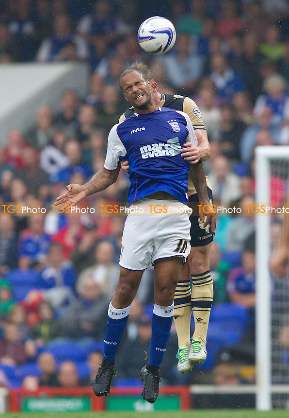 David McGoldrick of Ipswich Town beats Tom Lees, Leeds United to aerial ball - Ipswich Town vs Leeds United - Sky Bet Championship Football at Portman Road, Ipswich, Suffolk- 24/08/13 - MANDATORY CREDIT: Ray Lawrence/TGSPHOTO - Self billing applies where appropriate - 0845 094 6026 - contact@tgsphoto.co.uk - NO UNPAID USE