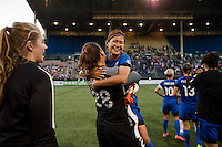 Seattle, WA - Saturday, July 02, 2016: Seattle Reign FC goalkeeper Haley Kopmeyer (28) celebrates Seattle Reign FC forward Nahomi Kawasumi's (36) return during a regular season National Women's Soccer League (NWSL) match between the Seattle Reign FC and the Boston Breakers at Memorial Stadium. Seattle won 2-0.