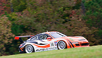 The #14 Porsche of Cory Friedman races past fall foliage during the Grand-Am Rolex Series test at Virginia International Raceway, Alton, VA , October 2010. (Photo by Brian Cleary/www.bcpix.com)
