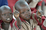 Children point during class in the Loreto Primary School in Rumbek, South Sudan. The Loreto Sisters began a secondary school for girls in 2008, with students from throughout the country, but soon after added a primary in response to local community demands.