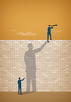 Businessman seeing over wall supported by helping hand