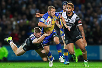 Picture by Alex Whitehead/SWpix.com - 29/09/2017 - Rugby League - Betfred Super League Semi-Final - Leeds Rhinos v Hull FC - Headingley Carnegie Stadium, Leeds, England - Leeds' Rob Burrow is tackled by Hull FC's Chris Green.