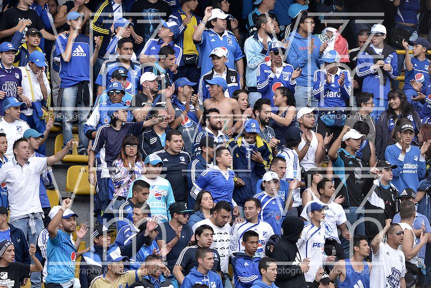 BOGOTA - COLOMBIA -09 -04-2016: Hinchas de Millonarios animan a su equipo durante partido entre Millonarios y Boyacá Chicó FC por la fecha 12 de la Liga Águila I 2016 jugado en el estadio Nemesio Camacho El Campín de la ciudad de Bogotá./ Fans of Millonarios cheer for their team during match between Millonarios and Boyaca Chico FC for the date 12 of the Aguila League I 2016 played at Nemesio Camacho El Campin stadium in Bogota city. Photo: VizzorImage / Gabriel Aponte / Staff.