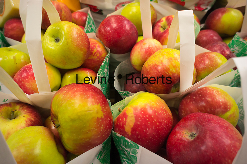 Local New York State apples on sale in a supermarket in New York on Saturday, September 1, 2012. Because of a long, warm summer with warm evenings the crop of New York State apples are earlier this year but the skins won't be colored as red as usual and the texture will be less crunchy.  (© Richard B. Levine)