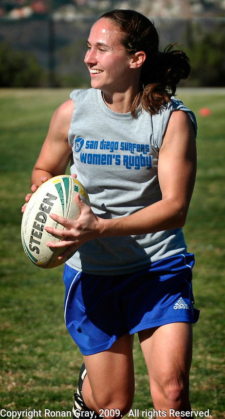 """Saturday, 01/17/09:  San Diego, California, USA:  Mandy Wilson charges forward during a mixed game of touch rugby at Torrey Highlands Park in Del Mar.  An informal group of players meet every Saturday morning at 11am for games.  The sport of Touch Rugby is a fast paced, exciting version of the full contact game that is gaining popularity in San Diego.  As the name suggests, the """"touch"""" version of it is not a full contact game - merely touching the player who is carrying the ball stops play.  Pick-up games can be found most Saturdays in the park and on Sunday mornings at the beach in Del Mar or Sunday afternoons in South Mission Beach. Wilson also plays with a more formal team, The San Diego Surfers - an all women's team based at Robb Field in Ocean Beach"""