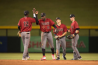 AZL Diamondbacks teammates Geraldo Perdomo (12), Kristian Robinson (10), Alek Thomas (5), and Kevin Watson, Jr. (7) celebrate after an Arizona League game against the AZL Cubs 1 at Sloan Park on June 18, 2018 in Mesa, Arizona. AZL Diamondbacks defeated AZL Cubs 1 7-0. (Zachary Lucy/Four Seam Images)