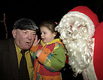 Little Erica Webb from Killarney prefers to tell Jackie Healy-Rae what she wants for christmnas aa santa can only look on at the switchin on of 3,000 light at Tim Clifford's home in Beaufort on Saturday.<br />Picture by Don MacMonagle
