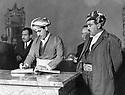 Iraq 1969?.Bagdhad: Kerim Khan at the republican palace signing the book for the Id al Adha<br /> <br /> Irak 1969?. A Bagdhad, Kerim Khan signe le livre des visiteurs a l'occasion des fetes de l'Id al Adha,  au palais de la Republique