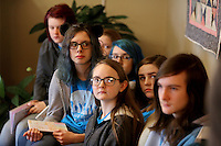 NWA Democrat-Gazette/DAVID GOTTSCHALK  Gentry Middle School students Amy Eckart (from the back), Naomi Brinkley, Paige Setzer, a ninth grader, Emaly (cq) Wilkins, Emily Jessen Autumn Broglen and Jaden Lothes, a ninth grader, listen Friday, February 24, 2017, to Ryan Worley, manager of the Washington Regional Cancer Support Home, during a visit to donate children's books to the home in Fayetteville. The students in the gifted and talented Quest class wrote, illustrated and published the children's books to help inform and comfort children that visit or stay at the home.