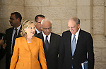 U.S. Secretary of State Hillary Clinton , Palestinian peace negotiator Saeb Erakat and US Special Envoy to the Middle East George Mitchell walk after their meeting at the Palestinian Authority headquarters in the West Bank city of Ramallah on Sept. 16, 2010 . Photo by Eyad Jadallah