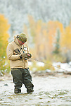 A young man fly fishes the Gros Ventre River in Jackson Hole, Wyoming.