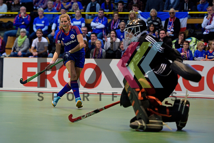 GER - Luebeck, Germany, February 07: During the 1. Bundesliga Damen indoor hockey final match at the Final 4 between Mannheimer HC (blue) and Duesseldorfer HC (white) on February 7, 2016 at Hansehalle Luebeck in Luebeck, Germany.   Laura Bassemir #25 of Mannheimer HC in action
