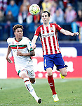 Atletico de Madrid's Diego Godin (r) and Granada Club de Futbol's Adalberto Penaranda during La Liga match. April 17,2016. (ALTERPHOTOS/Acero)
